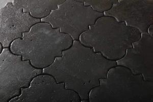 Foto delle mattonelle in cotto nero della linea Antico Restauro